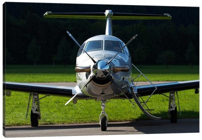 A Pilatus PC-12 Private Jet Canvas Art Print