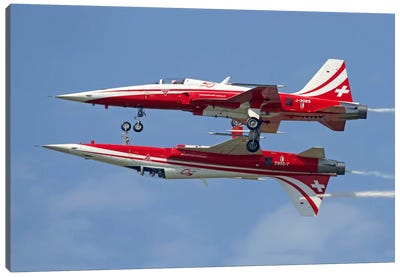 F-5 Tiger II Aircraft Of Patrouille Suisse Demonstrate The Calypso Pass Canvas Art Print