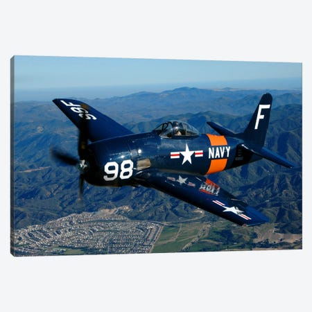 An F8F Bearcat Flying Over Chino, California Canvas Print #TRK384} by Phil Wallick Canvas Print