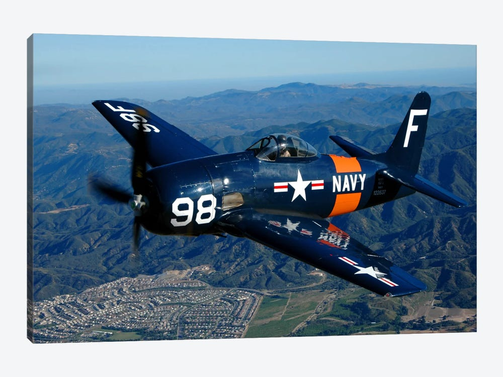 An F8F Bearcat Flying Over Chino, California by Phil Wallick 1-piece Art Print