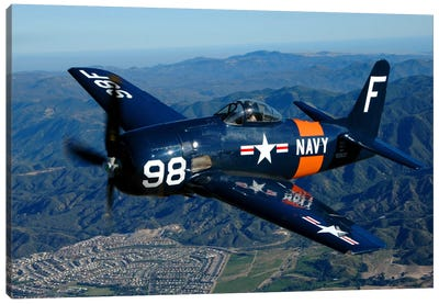 An F8F Bearcat Flying Over Chino, California Canvas Art Print