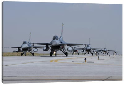A Squadron Of Turkish Air Force F-16C And F-16D Aircraft Taxiing On The Runway Canvas Art Print