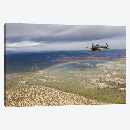A Japanese A6M Zero And A Ki-43 Oscar Fly In Formation Above A Rainbow Canvas Print #TRK432} by Rob Edgcumbe Canvas Artwork