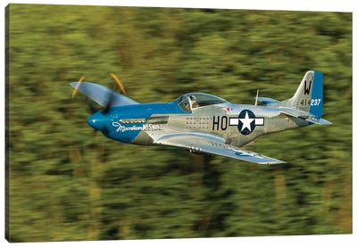 A P-51 Mustang Flies Along The Mississippi At Dubuque, Iowa Canvas Art Print