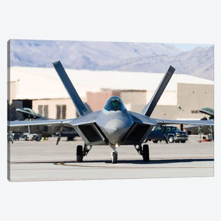 A US Air Force F-22A Raptor Taxiing At Nellis Air Force Base, Nevada Canvas Print #TRK447} by Rob Edgcumbe Canvas Wall Art