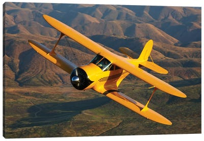 A Beechcraft Model B17R Staggerwing In Flight Canvas Art Print