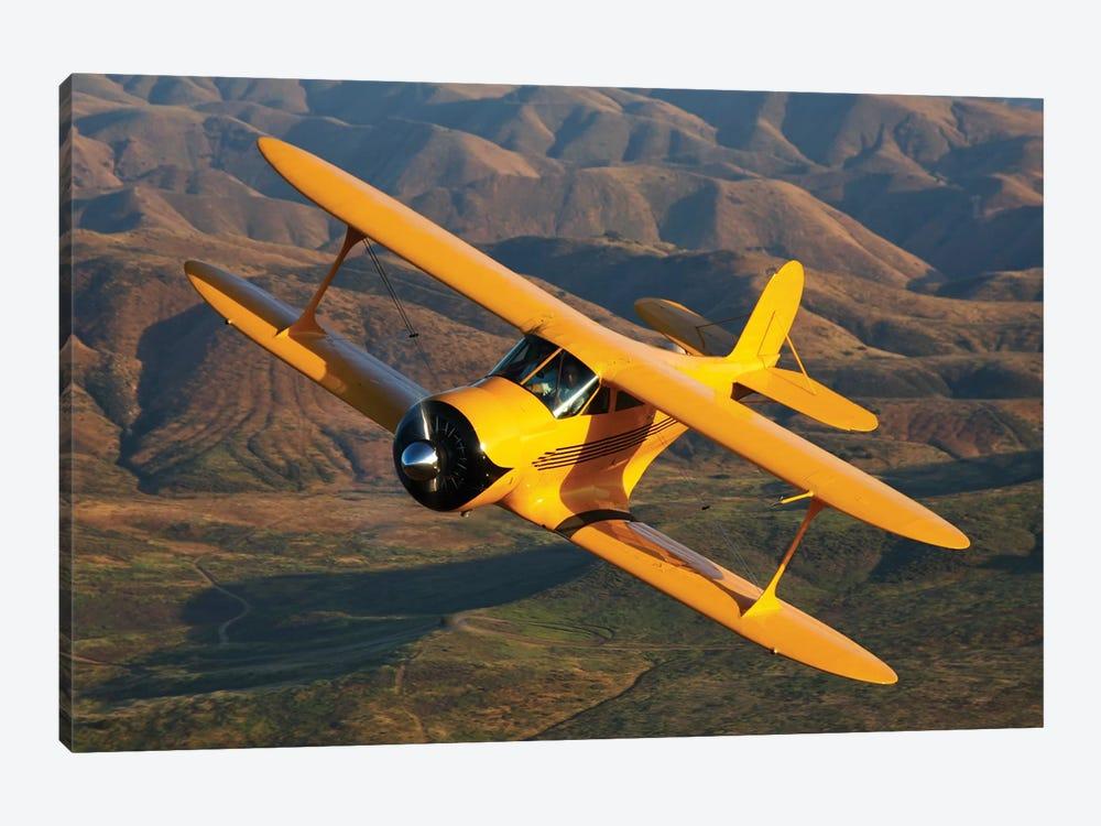 A Beechcraft Model B17R Staggerwing In Flight by Scott Germain 1-piece Canvas Art