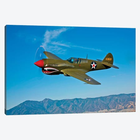 A Curtiss P-40E Warhawk In Flight Near Chino, California II Canvas Print #TRK468} by Scott Germain Canvas Print