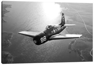 A Grumman F8F Bearcat In Flight Canvas Art Print