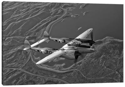 A Lockheed P-38 Lightning Fighter Aircraft In Flight I Canvas Art Print