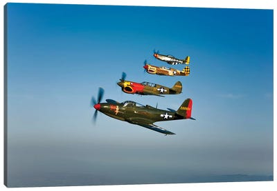 A P-36 Kingcobra, Two Curtiss P-40N Warhawks, And A P-51D Mustang In Flight Canvas Art Print