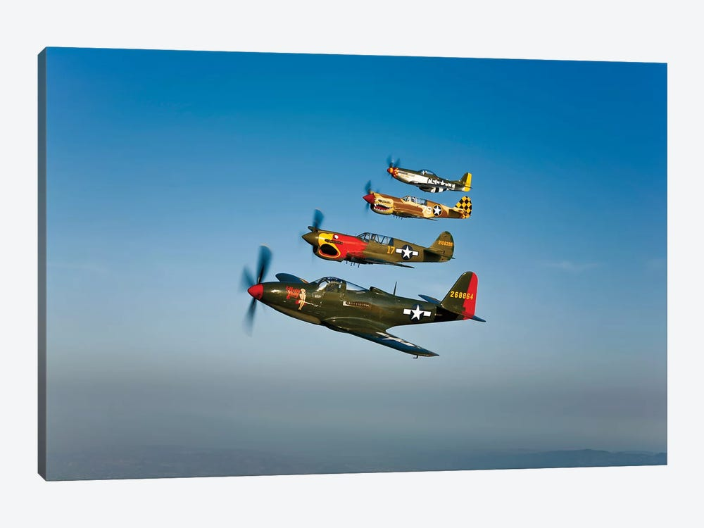 A P-36 Kingcobra, Two Curtiss P-40N Warhawks, And A P-51D Mustang In Flight by Scott Germain 1-piece Canvas Print
