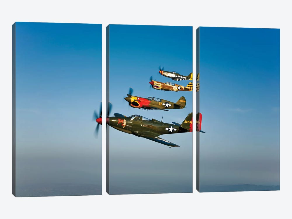 A P-36 Kingcobra, Two Curtiss P-40N Warhawks, And A P-51D Mustang In Flight by Scott Germain 3-piece Canvas Art Print