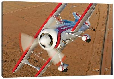 A Pitts Model 12 Biplane In Flight Canvas Art Print