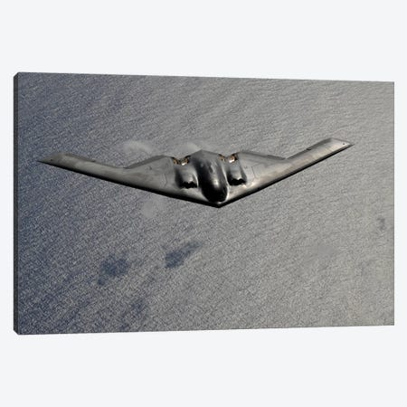 A B-2 Spirit Flies Over The Pacific Ocean Canvas Print #TRK516} by Stocktrek Images Canvas Art