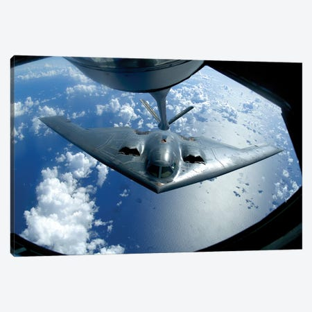 A B-2 Spirit Moves Into Position For Refueling From A KC-135 Stratotanker Canvas Print #TRK518} by Stocktrek Images Art Print