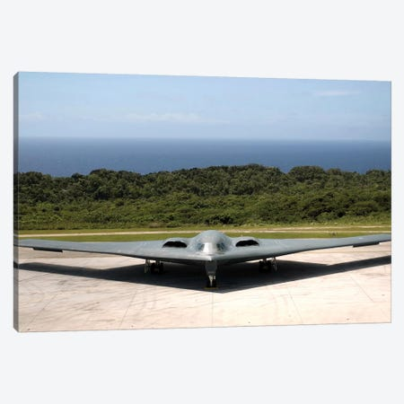 A B-2 Spirit Stealth Bomber Waits On The Flightline Canvas Print #TRK519} by Stocktrek Images Art Print