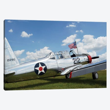 A BT-13 Valiant Trainer Aircraft With American Flag Canvas Print #TRK530} by Stocktrek Images Art Print