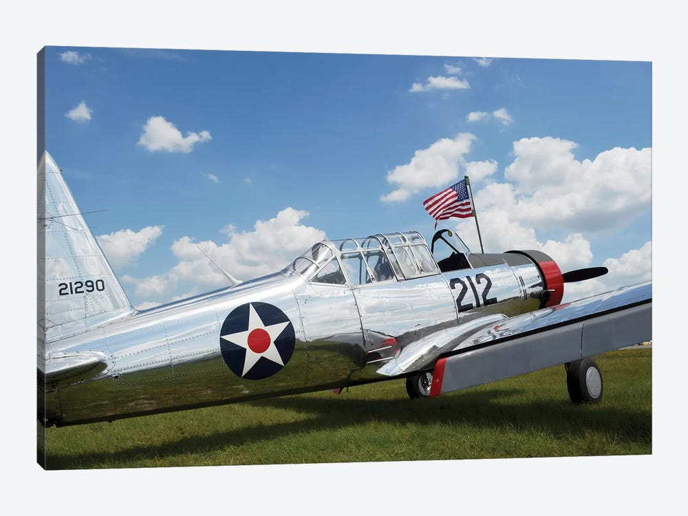 A BT-13 Valiant Trainer Aircraft With American Flag by Stocktrek Images 1-piece Canvas Artwork