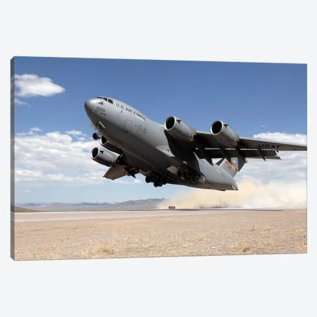 A C-17 Globemaster Departs From The Tonopah Runway Canvas Print #TRK531} by Stocktrek Images Canvas Art Print