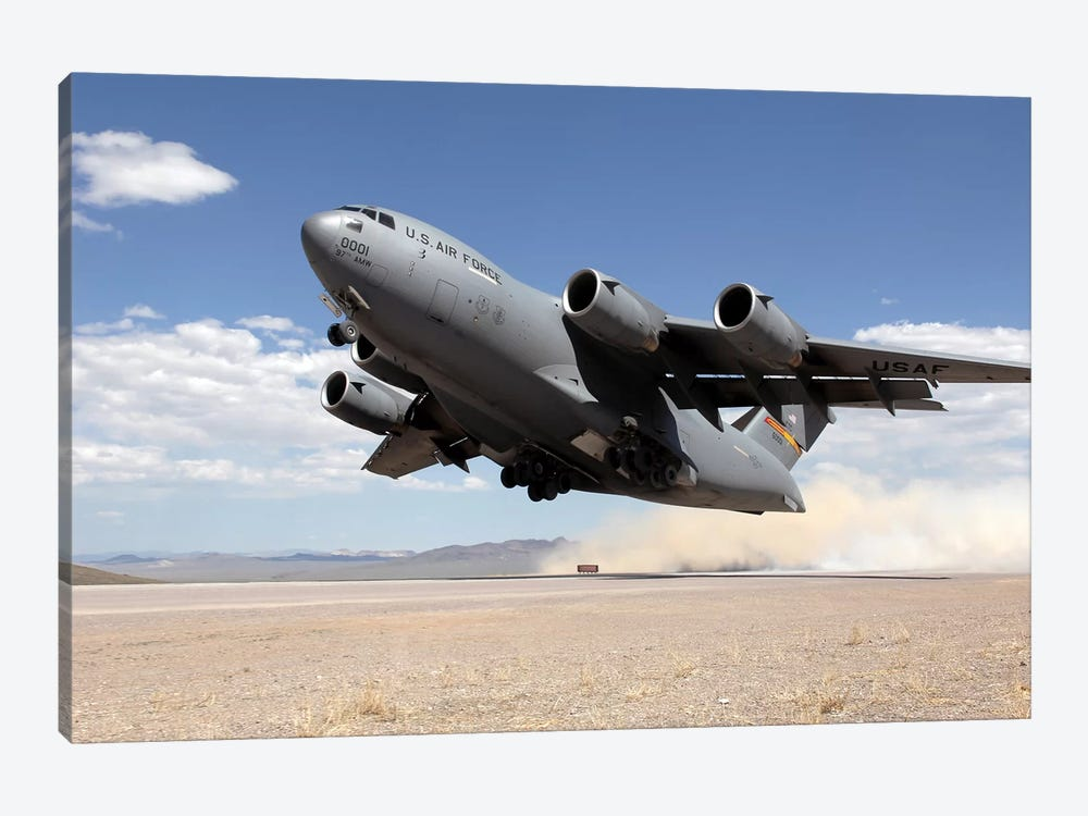 A C-17 Globemaster Departs From The Tonopah Runway by Stocktrek Images 1-piece Canvas Print