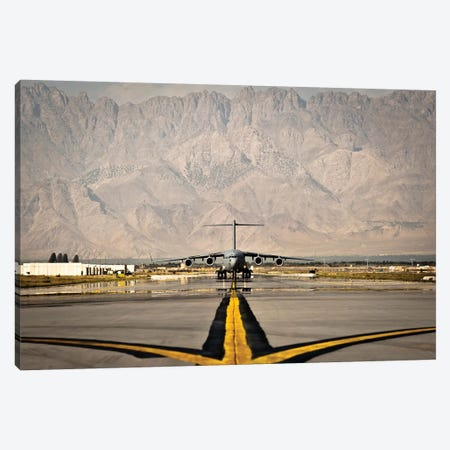 A C-17 Globemaster III Taxis To Its Parking Spot At Bagram Airfield Canvas Print #TRK536} by Stocktrek Images Canvas Artwork