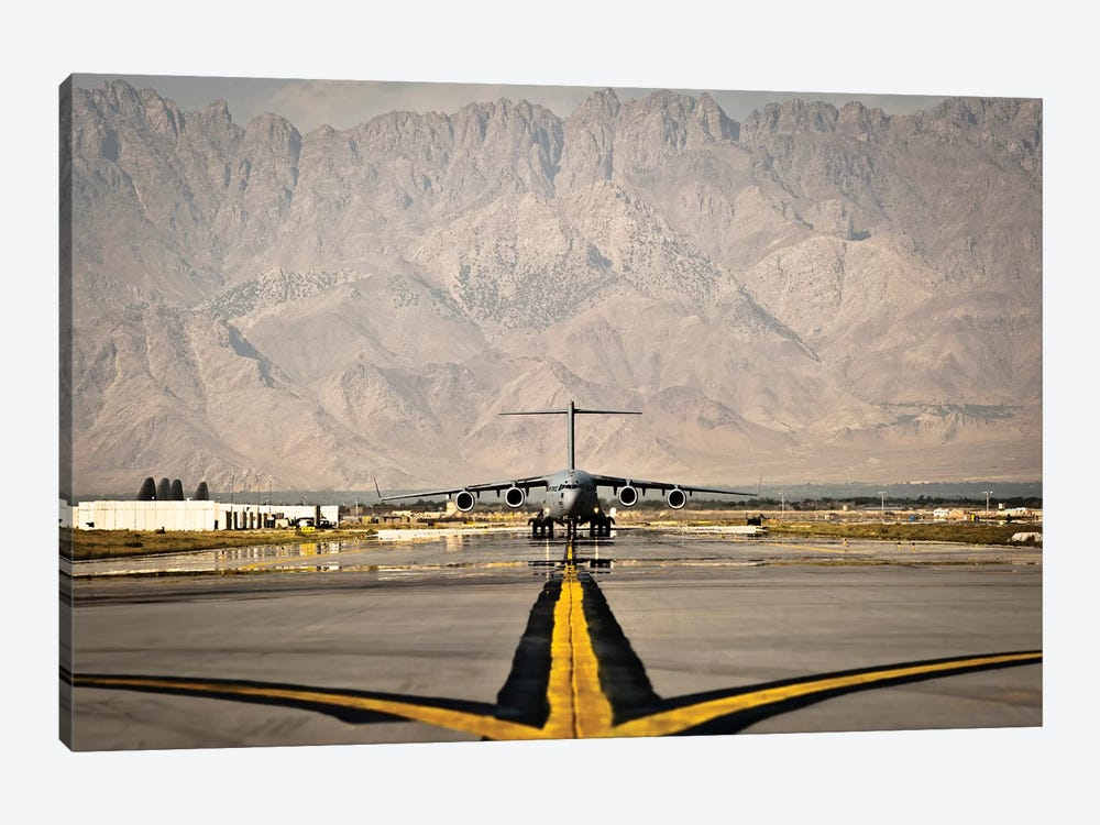 A C-17 Globemaster III Taxis To Its Parking Spot At Bagram Airfield by Stocktrek Images 1-piece Canvas Artwork