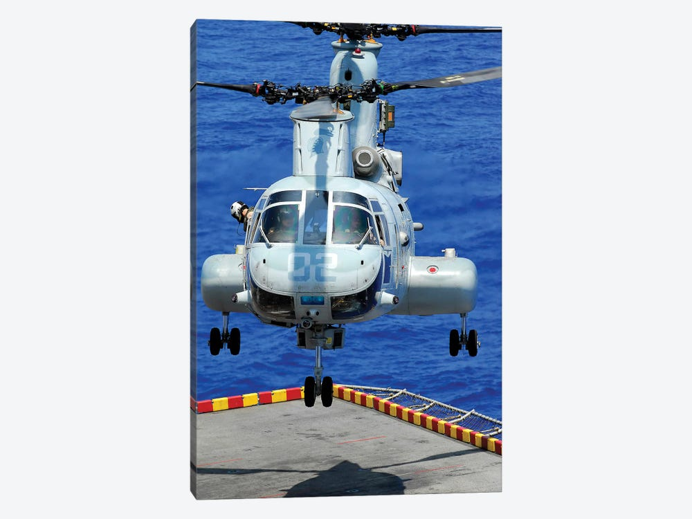 A CH-46E Sea Knight Helicopter Prepares To Land On The Flight Deck Of USS Peleliu by Stocktrek Images 1-piece Canvas Art