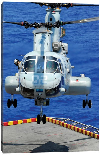 A CH-46E Sea Knight Helicopter Prepares To Land On The Flight Deck Of USS Peleliu Canvas Art Print