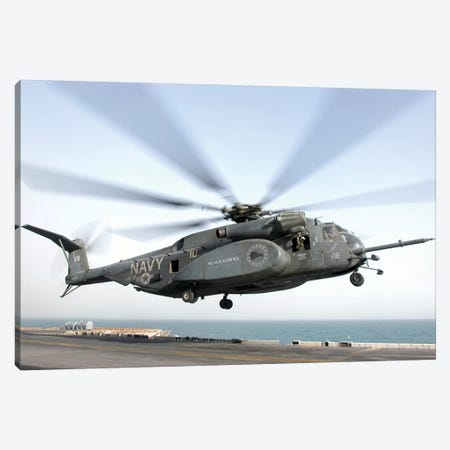 A CH-53 Sea Stallion Helicopter Leaves The Flight Deck Of USS Kearsarge Canvas Print #TRK540} by Stocktrek Images Canvas Artwork