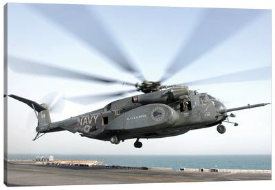 A CH-53 Sea Stallion Helicopter Leaves The Flight Deck Of USS Kearsarge Canvas Art Print