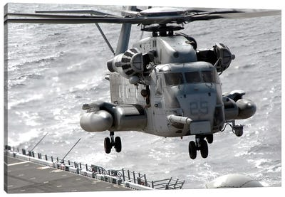 A CH-53E Super Stallion Helicopter Takes Off From USS Makin Island Canvas Art Print