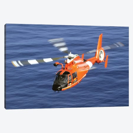 A Coast Guard HH-65A Dolphin Rescue Helicopter In Flight Canvas Print #TRK543} by Stocktrek Images Canvas Artwork