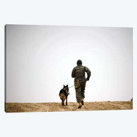 A Dog Handler And His Military Working Dog Take A Brisk Walk Canvas Print #TRK550} by Stocktrek Images Canvas Art Print