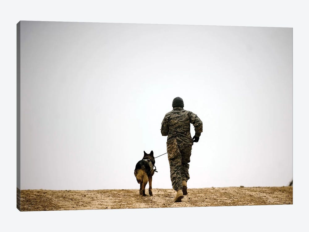 A Dog Handler And His Military Working Dog Take A Brisk Walk by Stocktrek Images 1-piece Canvas Wall Art