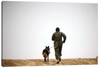 A Dog Handler And His Military Working Dog Take A Brisk Walk Canvas Art Print