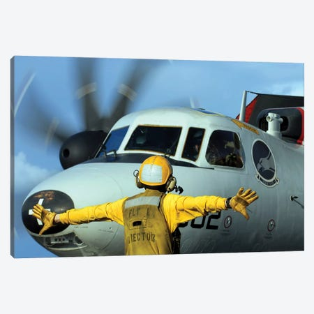 A Flight Deck Director Signals The Pilot Of An E-2C Hawkeye To Spread His Wings Canvas Print #TRK554} by Stocktrek Images Canvas Art