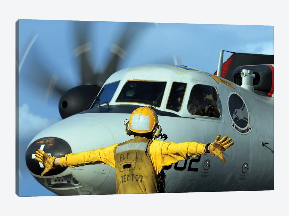 A Flight Deck Director Signals The Pilot Of An E-2C Hawkeye To Spread His Wings by Stocktrek Images 1-piece Canvas Wall Art
