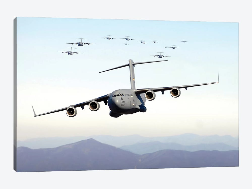 A Formation Of 17 C-17 Globemaster IIIs Fly Over The Blue Ridge Mountains by Stocktrek Images 1-piece Canvas Print
