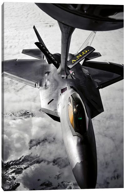 A KC-135 Stratotanker Refuels A F-22 Raptor Canvas Art Print
