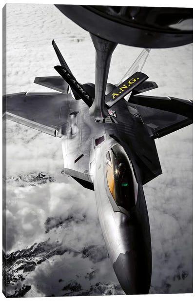 A KC-135 Stratotanker Refuels A F-22 Raptor Canvas Art Print