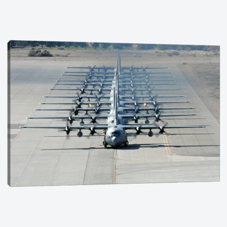 A Line Of C-130 Hercules Taxi At Nellis Air Force Base, Nevada Canvas Print #TRK562} by Stocktrek Images Canvas Wall Art