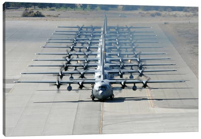A Line Of C-130 Hercules Taxi At Nellis Air Force Base, Nevada Canvas Art Print