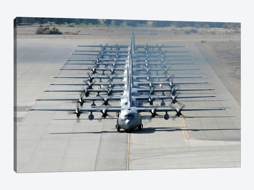 A Line Of C-130 Hercules Taxi At Nellis Air Force Base, Nevada by Stocktrek Images 1-piece Art Print