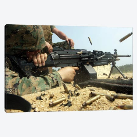 A Marine Engages Targets With An M-249 Squad Automatic Weapon Canvas Print #TRK566} by Stocktrek Images Art Print