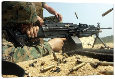 A Marine Engages Targets With An M-249 Squad Automatic Weapon Canvas Art Print