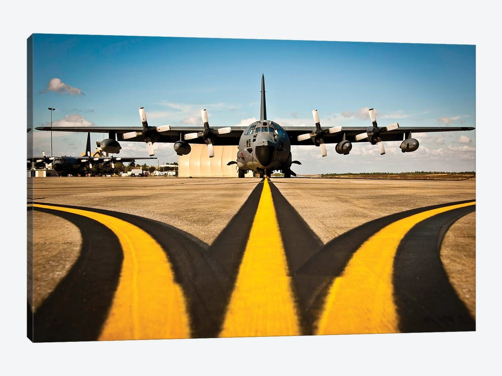 A MC-130E Combat Talon I Awaits Its Next Mission On The Flightline by Stocktrek Images 1-piece Canvas Art