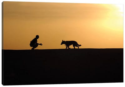 A Military Working Dog And His Handler Spend Time Together Canvas Art Print