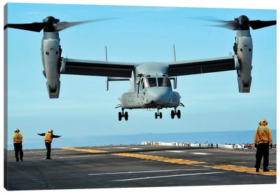 A MV-22 Osprey Aircraft Prepares To Land On The Flight Deck Canvas Art Print