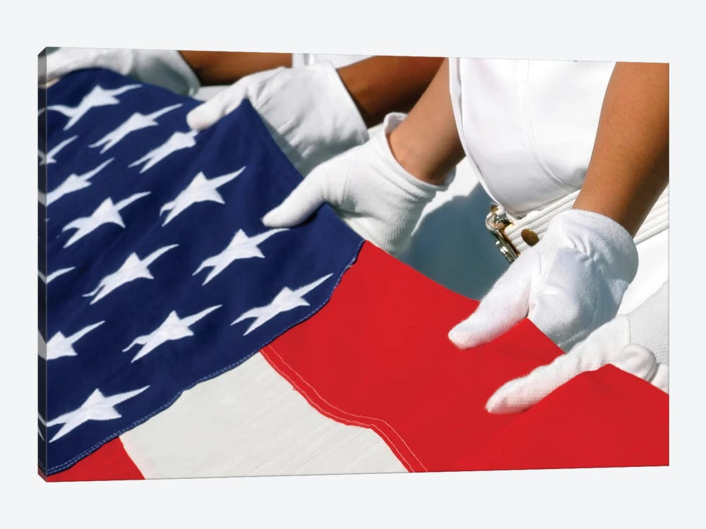 A Naval Station Pearl Harbor Ceremonial Guard Folds The National Ensign During A Burial Ceremony by Stocktrek Images 1-piece Art Print
